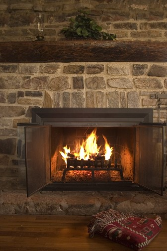 stone fireplace surround in a cabin