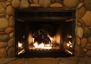 stone fireplace with gas log insert